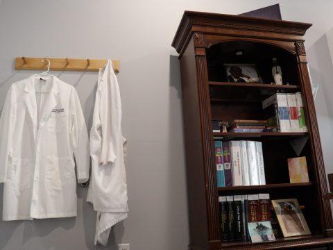 sleep medicine doctor attire and bookshelf